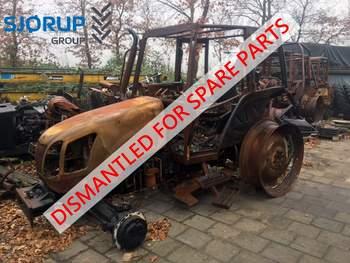 salg af New Holland TLA 100 traktor