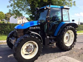 salg af New Holland TS115 traktor