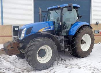 salg af New Holland T 7050 traktor
