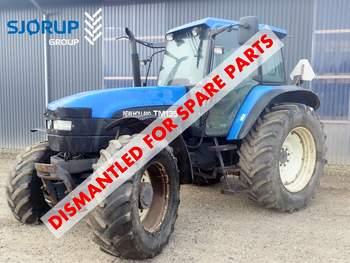 salg af New Holland TM135 traktor
